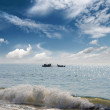 Landscape with fisherman boats in sea — Stock Photo