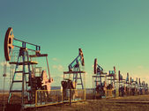 Many working oil pumps in row - vintage retro style — Stock Photo