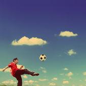 Asian boy playing football - vintage retro style — Stock Photo