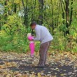 Stock Video: Father playing with baby in autumn park