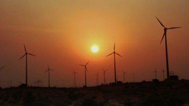 Wind farm - turning windmills against timelapse sunset — Stockvideo