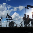 Stock Video: Working oil pumps silhouette against timelapse clouds