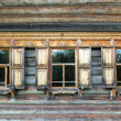 Old russian wooden house with decorated windows — Stock Photo