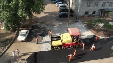 Timelapse - workers laid asphalt with special equipment in Ufa — Stock Video