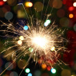 Sparkler burning on festive background — Stock Photo