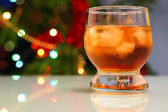 Whiskey with ice against festive lights background — Foto Stock