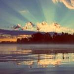 Beautiful sunrise on river - vintage retro style — Stock Photo #39449625