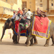 Stock Photo: Tourists on elephants in Jaipur fort India