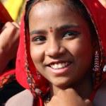 Portrait of smiling Indian girl at Pushkar camel fair — Stock Photo