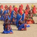 Indian girls dancing at Pushkar camel fair — Stock Photo #39954753