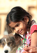 Portrait of village indian girl with dog on background — Stock Photo