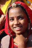 Portrait of smiling Indian girl at Pushkar camel fair — Stock Photo
