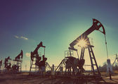 Working oil pumps silhouette - vintage retro style — Stock Photo