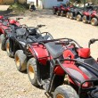 Stock Photo: Quad bikes atv in row