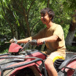 Happy asian boy on quad bike atv — Stock Photo