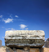 Fragment of ancient ruins with lettering — Stock Photo