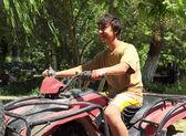 Happy asian boy on quad bike atv — Stock Photo