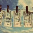 Stock Photo: Paper dollars are drying on rope - vintage retro style