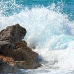 Sea waves breaking on rocks — Stock Photo #40860129