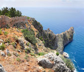 Rocky headland in sea and fortress wall in Alanya — Stock Photo
