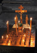 Candles and crucifix in church — Stock Photo