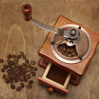 Vintage coffee grinder and beans — Stock Photo