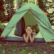 Happy boy in camping tent - vintage retro style — Stock Photo #44010983