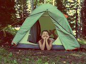 Happy boy in camping tent - vintage retro style — Stock Photo