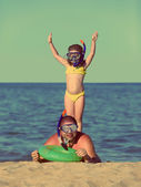 Father and daughter in scuba mask - vintage retro style — Stock Photo
