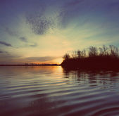 River landscape with sunset - vintage retro style — Stock Photo