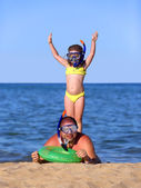 Father and daughter on beach in scuba mask — Stock Photo