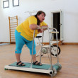 Tired overweight woman on trainer treadmill — Stock Photo #46995375