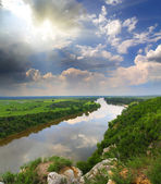 Landscape with river and rain on horizon — Stock Photo