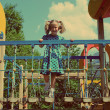 Little girl on playground - vintage retro style — Stock Photo