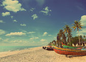 Old fishing boats on beach - vintage retro style — Stock Photo