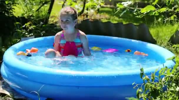 stock video girl in inflatable pool