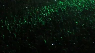 Numerous of Cheering crowd in a concert hall in Kyiv, Ukraine
