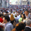 Blurred crowd of unrecognizable at the street - Stock Photo
