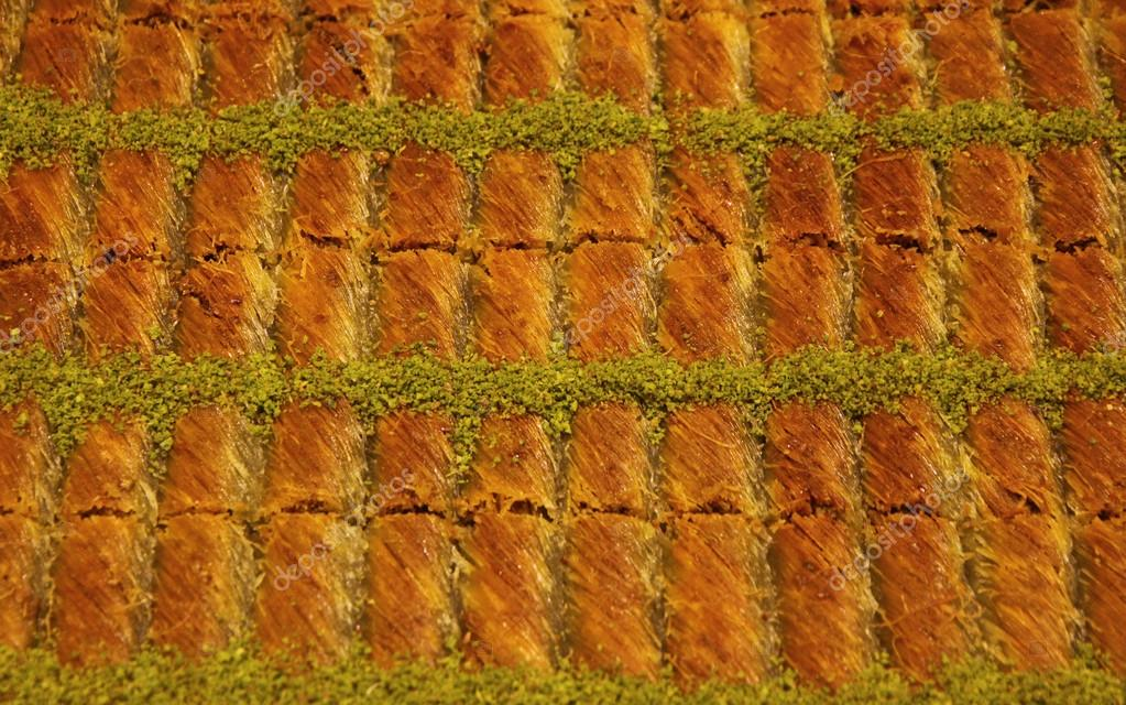 Close-up traditional Turkish baklava (sweet dessert made of thin pastry, nuts and honey)  Stock Photo #12716647