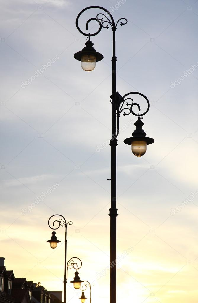 Retro-styled lamppost on the street of Warsaw, Poland — Stock Photo #13593181