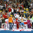 England fans celebrate after scoring against Sweden - Stock Photo