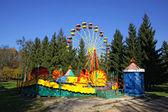 Vintage Merry-Go-Round and Ferris wheel — Stock Photo