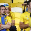 Foto de Stock  : Swedish soccer fans react after England beat of Sweden