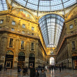 MILAN, ITALY - DECEMBER 31, 2010: People walking inside the Galleria Vittorio Emanuele - famous shopping gallery with elegant boutiques and fashion creator outlets on December 31, 2010 in Milan, Italy — Stock Photo