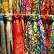 Colourful silk scarfs hanging at a market stall in Istanbul - Stock Photo