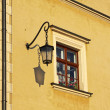 Close-up yellow building with window and street lamp — Stock Photo #19636617
