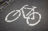 Bicycle sign on the road — Stock Photo