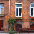 Facade of typical German residential house in Lubeck — Stock Photo #24278791