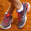 Tennis player legs on the clay court — Stock Photo