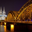 Cologne Cathedral and bridge over the Rhine river, Germany - Stock Photo